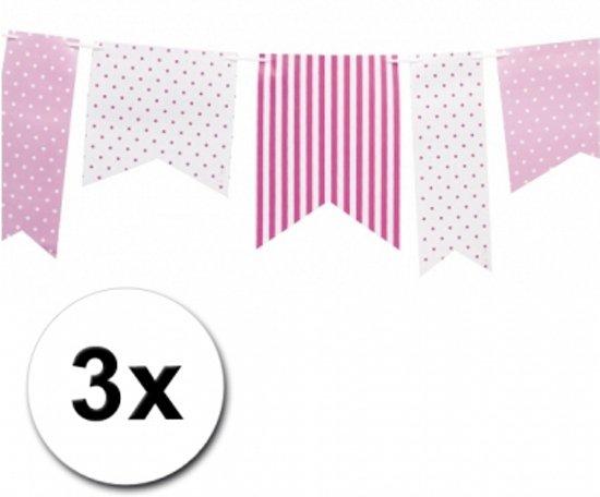 3 lichtroze vlaggenlijnen met stippen in de Woude