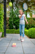 Tennistrainer met massief rubberhout blok
