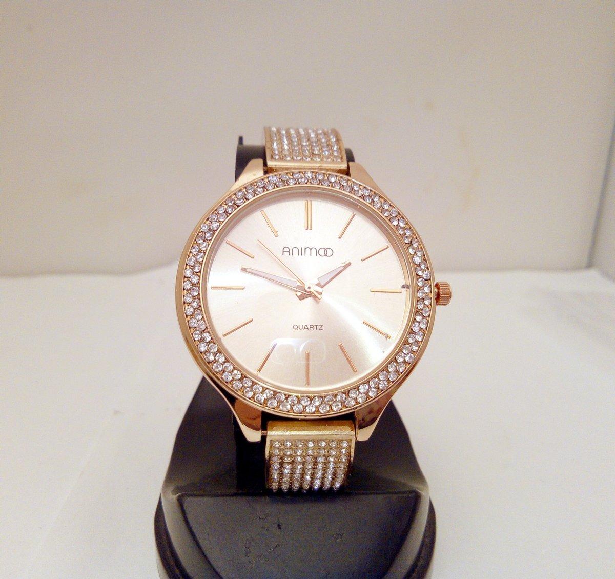 Schitterend roséplated horloge met veel strass kopen