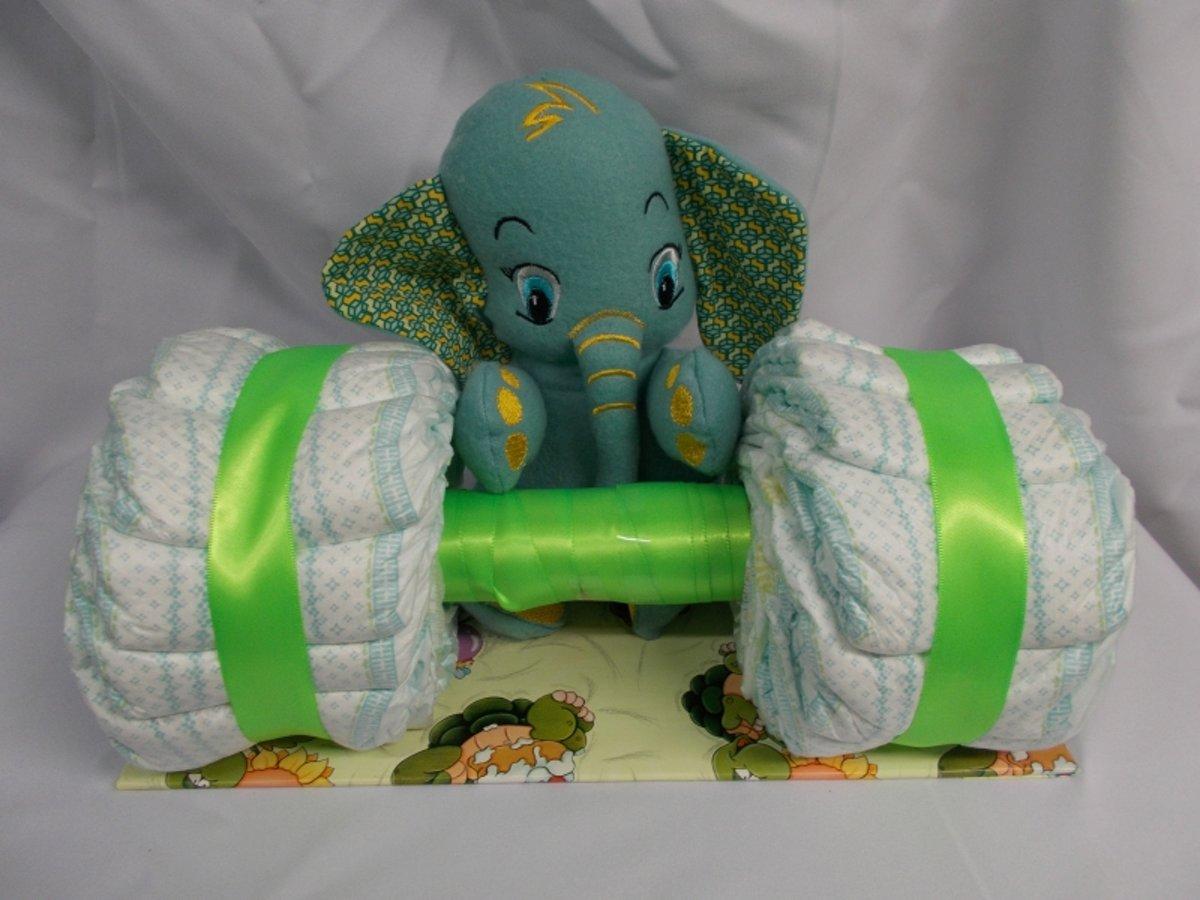 Gewichtheffer met knuffel olifant olli groen