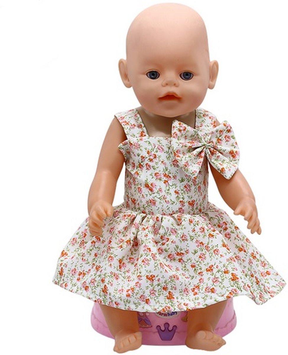 f414a0972ceee8 ... Baby born poppenkleertjes - Jurkje met bloemetjes print en grote strik  - Poppenkleertjes ...