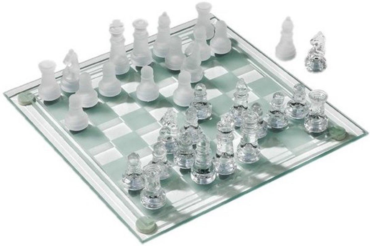 Schaakspel met glazen schaakstukken + boek schaken veel meer dan zwart en wit