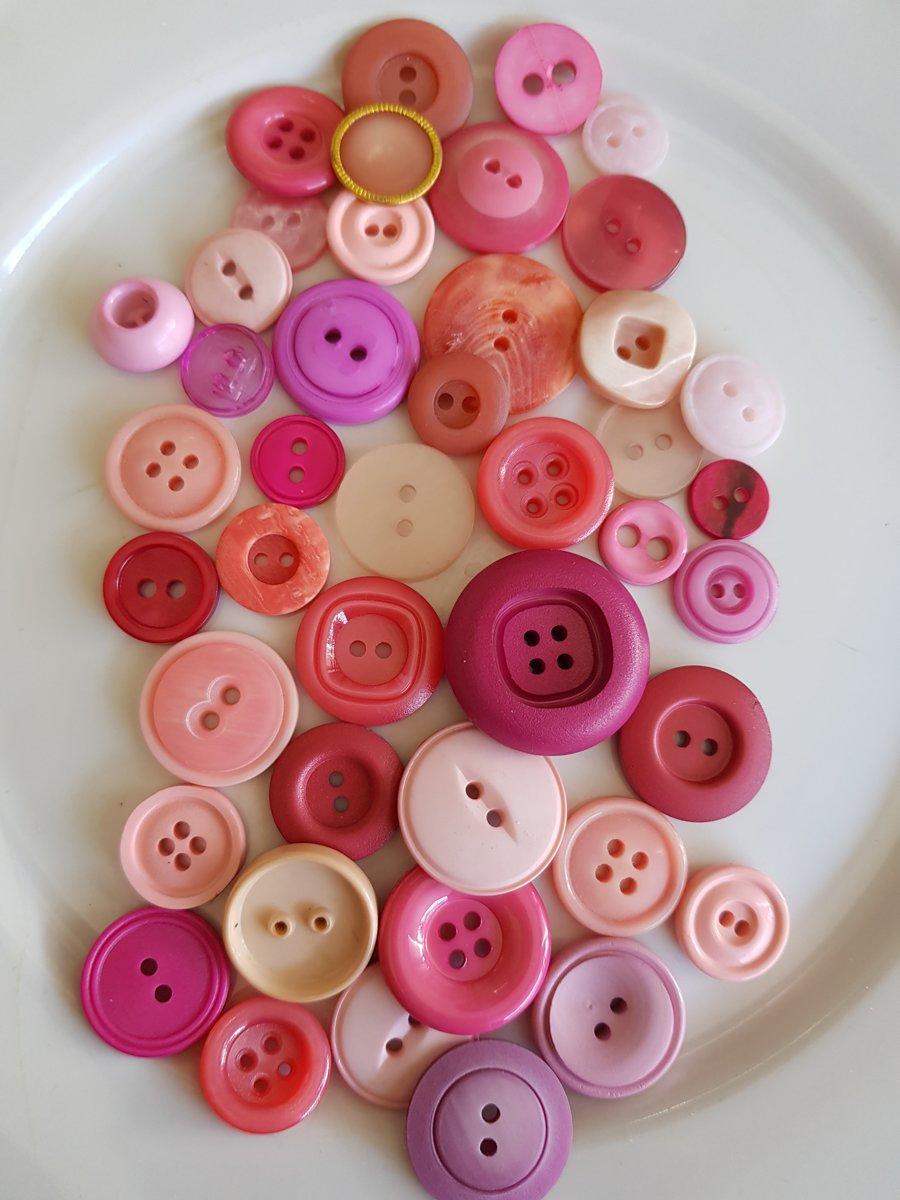 Knopen roze kopen