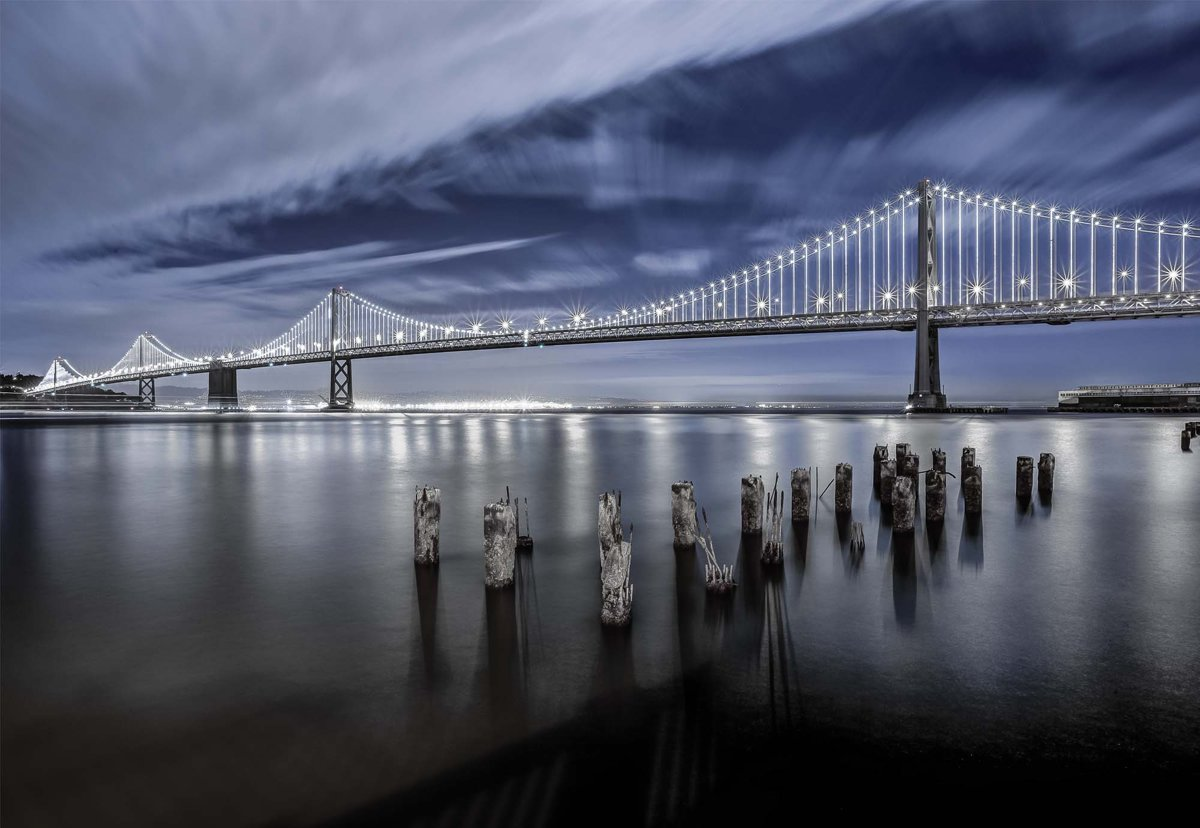 Fotobehang The Bay Bridge Lights San Francisco V4 - 254cm x 184cm Premium Non-Woven Vlies 130gsm kopen
