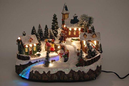 Kerstdorp met schaatsers warm white led