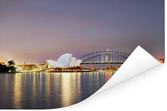 Sydney Opera House in de avond met een verlicht Sydney Poster 90x60 cm - Foto print op Poster (wanddecoratie woonkamer / slaapkamer)