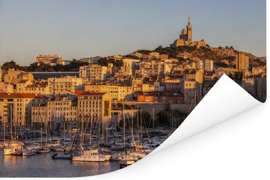 Zonnestralen van de laagstaande zon over Marseille in Frankrijk Poster 120x80 cm - Foto print op Poster (wanddecoratie woonkamer / slaapkamer) / Europese steden Poster