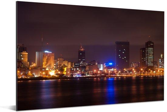 Skyline van Abidjan in de avond Aluminium 120x80 cm - Foto print op Aluminium (metaal wanddecoratie)