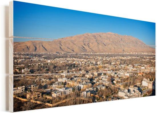 Zonnige dag boven Shiraz in het Aziatische Iran Vurenhout met planken 80x40 cm - Foto print op Hout (Wanddecoratie)