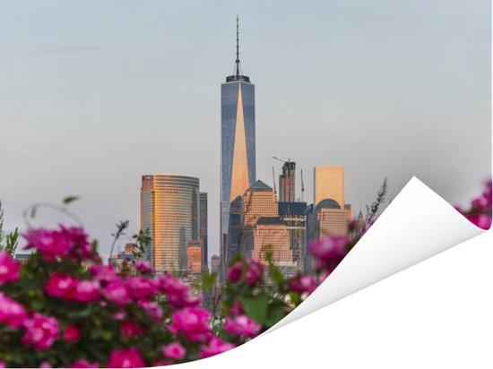 Roze bloemen voor het World Trade Center in New York Poster 160x120 cm - Foto print op Poster (wanddecoratie woonkamer / slaapkamer) XXL / Groot formaat!