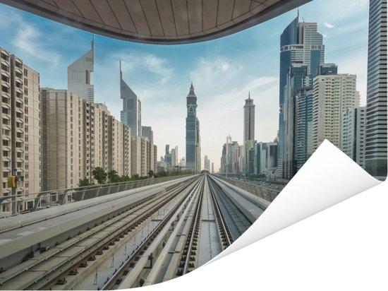 Uitzicht vanaf een spoorweg op de stad Dubai Poster 160x120 cm - Foto print op Poster (wanddecoratie woonkamer / slaapkamer) XXL / Groot formaat!