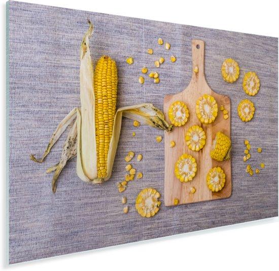 Gesneden maïskolven op een hakbord Plexiglas 60x40 cm - Foto print op Glas (Plexiglas wanddecoratie)