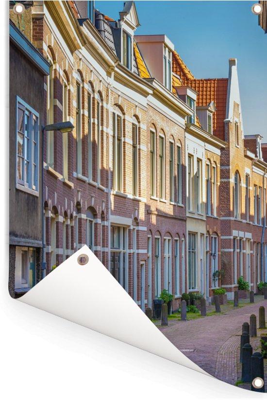Gezellige straat in de Nederlandse stad Haarlem Tuinposter 80x120 cm - Tuindoek / Buitencanvas / Schilderijen voor buiten (tuin decoratie)