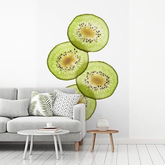 Fotobehang vinyl - Stapeltje kiwi plakken met doorschijnend licht breedte 335 cm x hoogte 500 cm - Foto print op behang (in 7 formaten beschikbaar)