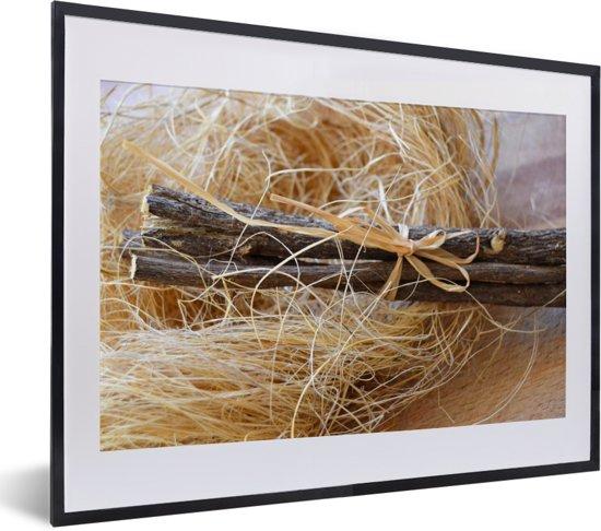 Foto in lijst - Bundel zoethout op een tafel fotolijst zwart met witte passe-partout klein 40x30 cm - Poster in lijst (Wanddecoratie woonkamer / slaapkamer)