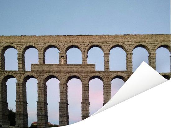 Foto van het aquaduct van Segovia in Europa tijdens de avond Poster 40x30 cm - klein - Foto print op Poster (wanddecoratie woonkamer / slaapkamer)