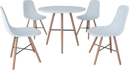 witte ronde eettafel met stoelen