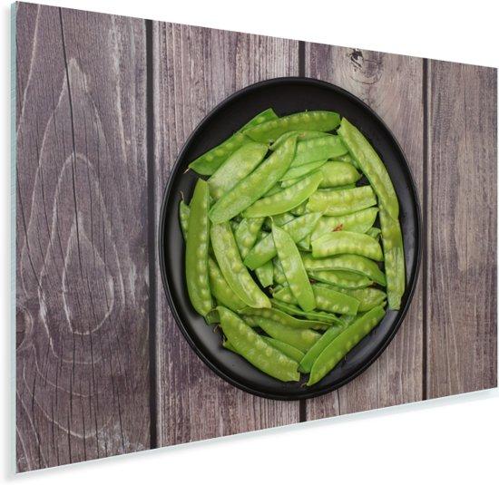 Peultjes in een zwarte kom op een houten ondergrond Plexiglas 60x40 cm - Foto print op Glas (Plexiglas wanddecoratie)
