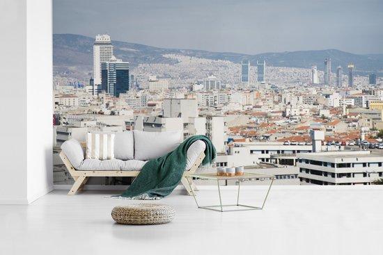Fotobehang vinyl - Stedelijke horizon van de stad van Izmir in Turkije breedte 430 cm x hoogte 240 cm - Foto print op behang (in 7 formaten beschikbaar)