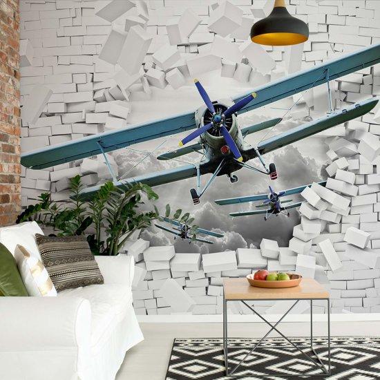 Fotobehang 3D Plane Bursting Through Brick Wall | VEXXXL - 416cm x 254cm | 130gr/m2 Vlies