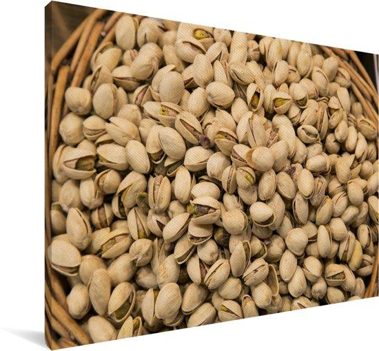 Hoop pistachenoten in een rieten mand Canvas 140x90 cm - Foto print op Canvas schilderij (Wanddecoratie woonkamer / slaapkamer)