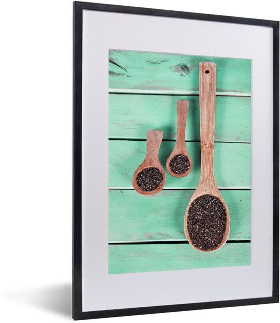 Foto in lijst - Groenblauw hout met houten lepels vol met chiazaad fotolijst zwart met witte passe-partout klein 30x40 cm - Poster in lijst (Wanddecoratie woonkamer / slaapkamer)