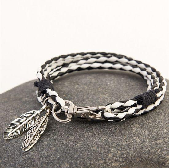 9c99abd927d bol.com | Wit met zwarte heren armband voorzien van veer