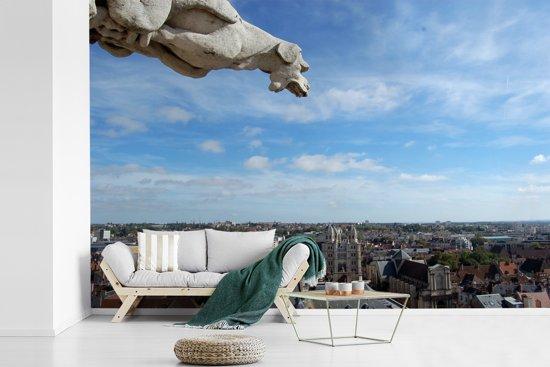 Fotobehang vinyl - Standbeeld over de Franse stad Dijon breedte 420 cm x hoogte 280 cm - Foto print op behang (in 7 formaten beschikbaar)