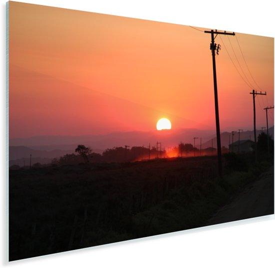Een afbeelding van de zonsondergang bij een weg met elektrische polen in het prachtige Santa Marta Plexiglas 60x40 cm - Foto print op Glas (Plexiglas wanddecoratie)