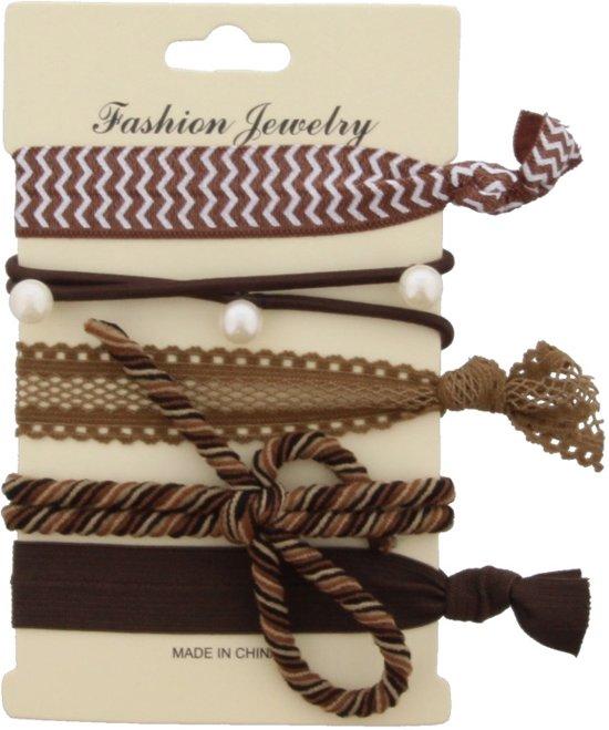Ibiza elastiekjes die ook als armbandje te gebruiken zijn.