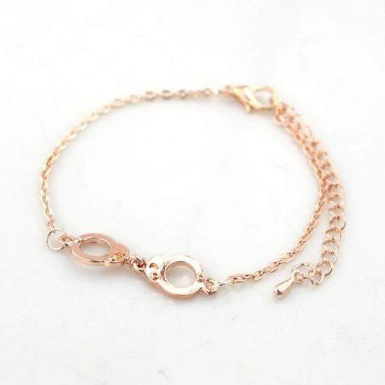 Dielay Armband - Handboeien - Rosekleurig - 21 cm