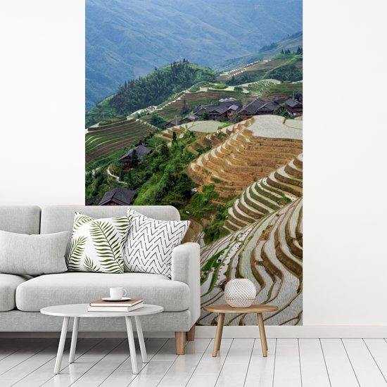 Fotobehang vinyl - Overzicht over de Rijstterrassen van Lóngjĭ breedte 215 cm x hoogte 320 cm - Foto print op behang (in 7 formaten beschikbaar)
