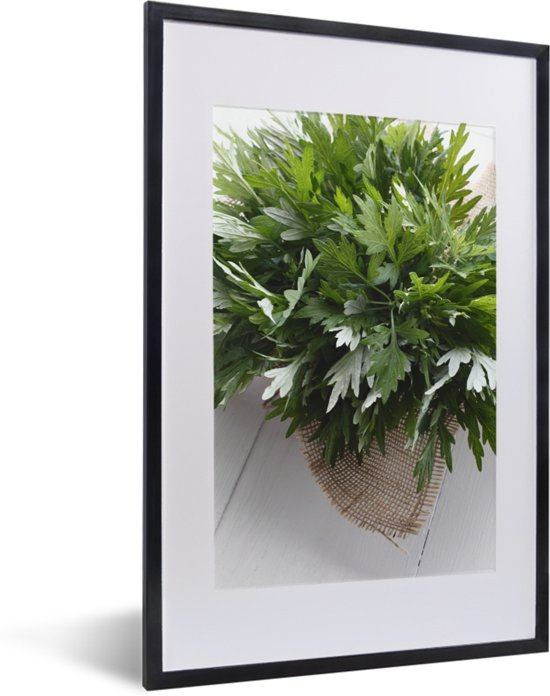 Foto in lijst - De bladeren van alsem die samen op een stoffen zak fotolijst zwart met witte passe-partout 40x60 cm - Poster in lijst (Wanddecoratie woonkamer / slaapkamer)