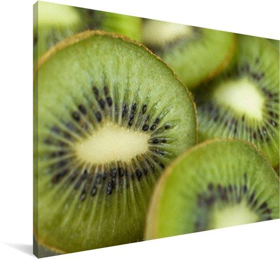 Plakjes kiwi met veel overlap op een bord Canvas 180x120 cm - Foto print op Canvas schilderij (Wanddecoratie woonkamer / slaapkamer) XXL / Groot formaat!