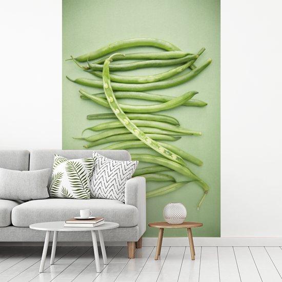 Fotobehang vinyl - Groene pronkbonen tegen een groene achtergrond breedte 180 cm x hoogte 270 cm - Foto print op behang (in 7 formaten beschikbaar)