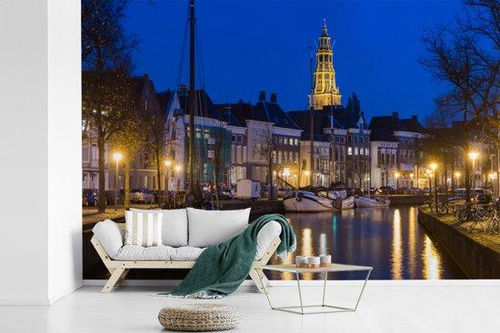 Fotobehang vinyl - Blauwe lucht boven de Martini toren en de grachten van Groningen breedte 540 cm x hoogte 360 cm - Foto print op behang (in 7 formaten beschikbaar)