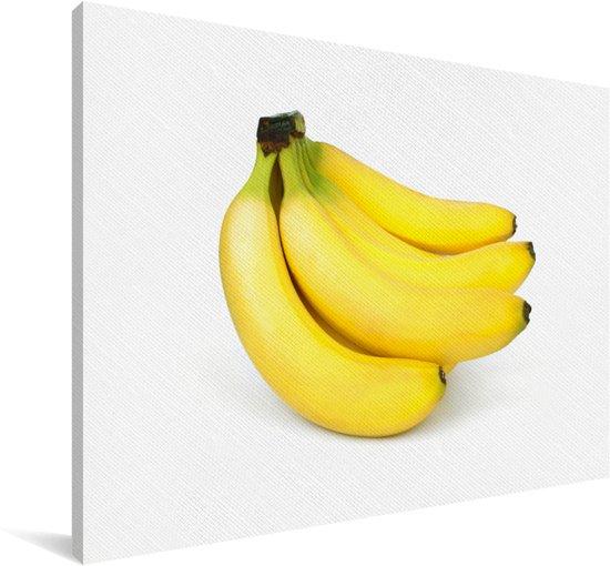 Tros bananen op een witte achtergrond Canvas 90x60 cm - Foto print op Canvas schilderij (Wanddecoratie woonkamer / slaapkamer)