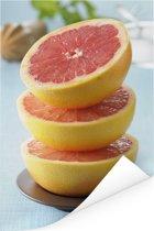 Een stapel grapefruit in een kom Poster 80x120 cm - Foto print op Poster (wanddecoratie woonkamer / slaapkamer)