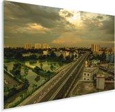 Gele tinten in de lucht boven Dhaka Plexiglas 30x20 cm - klein - Foto print op Glas (Plexiglas wanddecoratie)