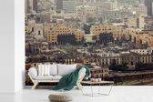 Fotobehang vinyl - Luchtfoto van de gebouwen in Lima breedte 420 cm x hoogte 280 cm - Foto print op behang (in 7 formaten beschikbaar)