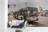 Fotobehang vinyl - Een morderne Duitse stadsbus breedte 525 cm x hoogte 350 cm - Foto print op behang (in 7 formaten beschikbaar)