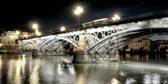Brug in Sevilla, de puente San Telmo, Spanje, Andalusië in olieverf look | gebouw, modern, stad, sfeer | Foto schilderij print op Canvas (canvas wanddecoratie) | 120x60cm