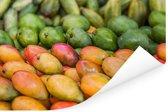 Rijpe mango's op een markt Poster 120x80 cm - Foto print op Poster (wanddecoratie woonkamer / slaapkamer)