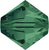 Swarovski 5328 Xilion Facet kraal 6mm Emerald