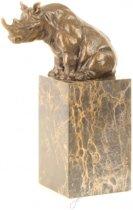 Bronzen beeld van een zittende neushoorn