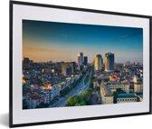 Foto in lijst - Luchtfoto van het Aziatische Hanoi bij een kleurrijke zonsondergang fotolijst zwart met witte passe-partout 60x40 cm - Poster in lijst (Wanddecoratie woonkamer / slaapkamer)