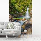 Fotobehang vinyl - Waterval in het Nationaal park van Abel Tasman breedte 335 cm x hoogte 500 cm - Foto print op behang (in 7 formaten beschikbaar)