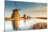 Molens van Kinderdijk bij zonsondergang in Nederland Aluminium 90x60 cm - Foto print op Aluminium (metaal wanddecoratie)