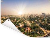 Zonnestralen achter Karachi in Pakistan Tuinposter 40x30 cm - klein - Tuindoek / Buitencanvas / Schilderijen voor buiten (tuin decoratie)