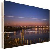 De rivier Ganges tijdens de schemering van Allahabad in India Vurenhout met planken 120x80 cm - Foto print op Hout (Wanddecoratie)